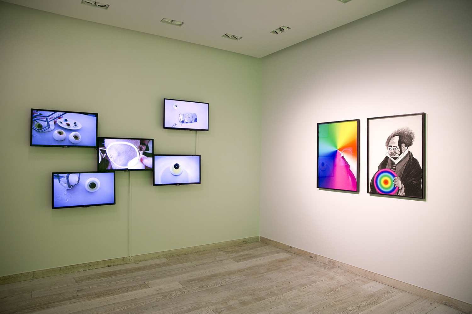 (L) Lou Hubbard, Eye Ops (2013), 5 x single channel videos. Courtesy of the artist and Sarah Scout Presents, Melbourne (R) Veronica Kent, 'Clown Transfer 1' and 'Clown Transfer 2', digital prints framed.  Courtesy of the artist and Sarah Scout Presents, Melbourne