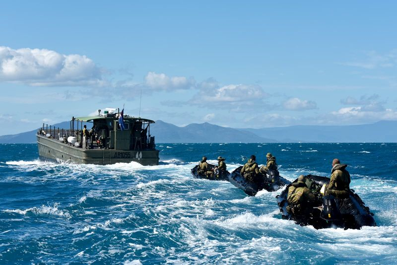 Members of the Australian Defence Force participate in helocasting exercises
