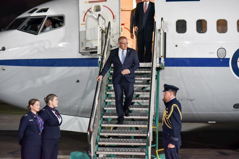 PM Morrison exits plane