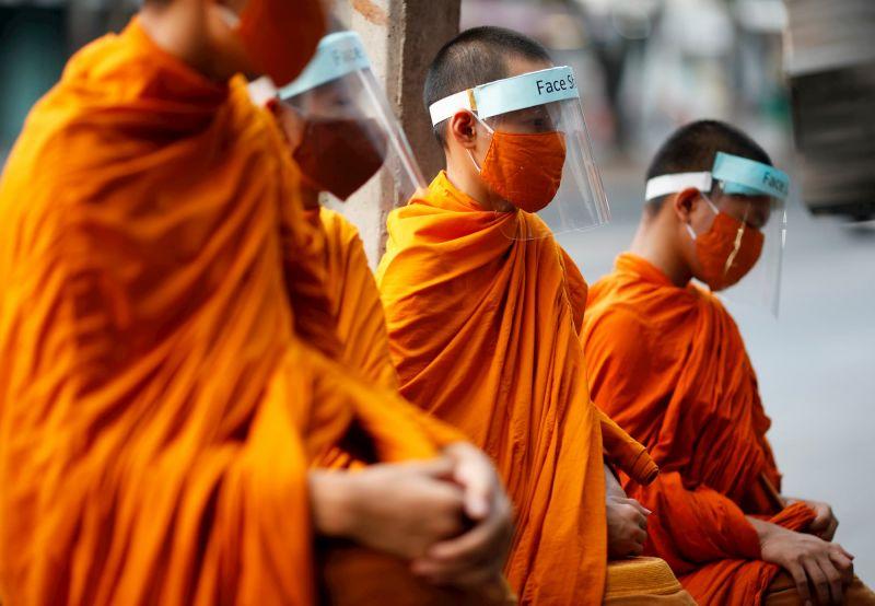 Thai monks practice social distancing measures