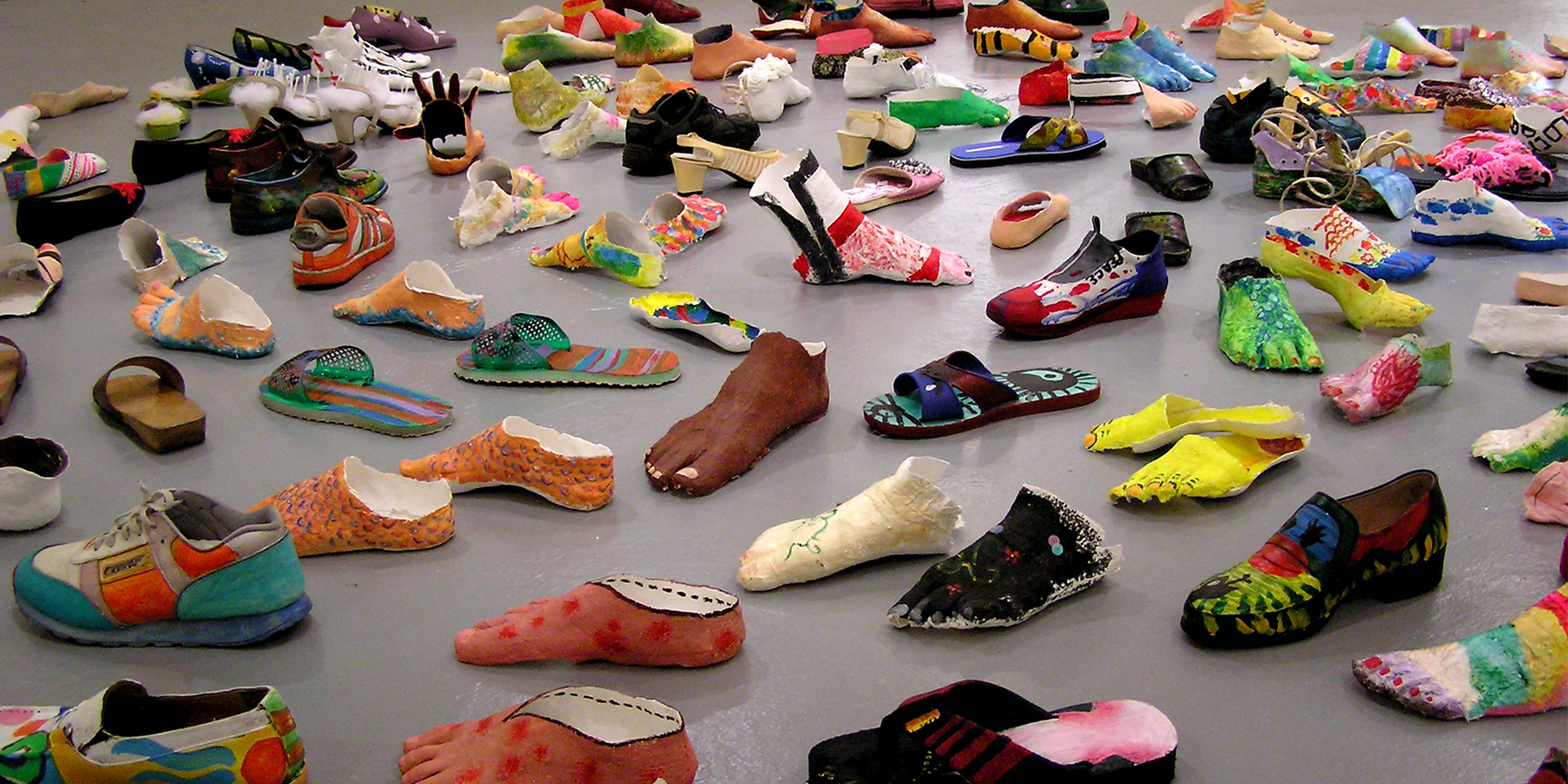 My Le Thi, Walk the Earth 1995-2005, Installation view with shoes, plaster-cast feet, video, Dimensions variable