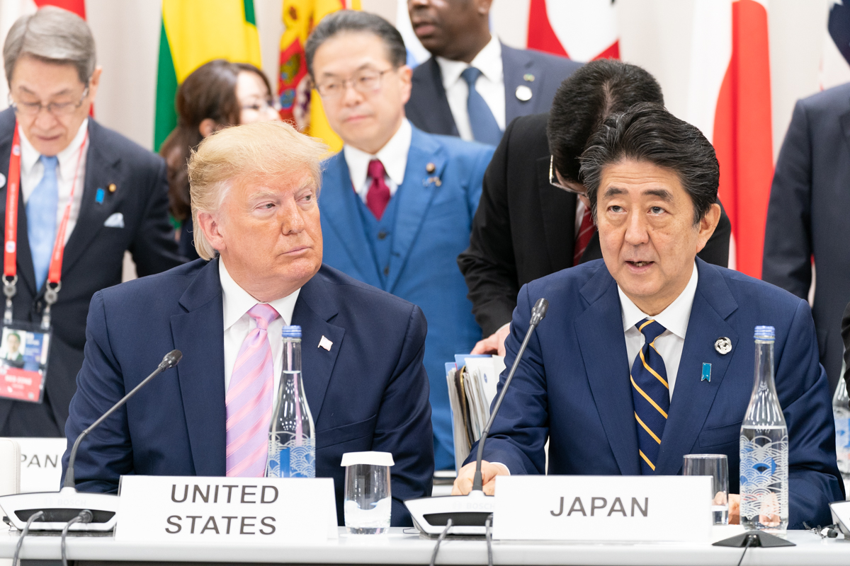 President Donald J. Trump listens as Japanese Prime Minister Shinzo Abe delivers remarks at the G20 Leaders Special Event