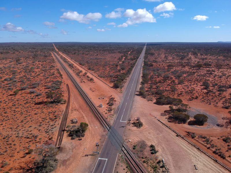 Ghan railway crosses the Stuart Highway