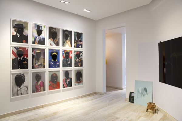(L) Tony Garifalakis, Mob Rule (Family) (2013), 21 x digital prints (framed). Courtesy of the artist and Hugo Michel Gallery, Adelaide (R) Clare Milledge, Academic Suspicion - Staging a Hermeneutics of Incommensurability (2015), 5 x paintings (on glass), masks, textiles, scultural objects.  Courtesy of the artist and The Commercial, Sydney